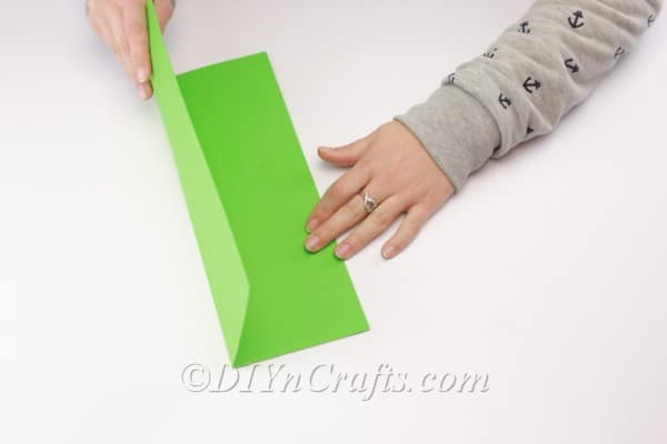 Folding the second shape of construction paper.