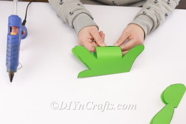 Making the body three dimensional by attaching the bottom part.