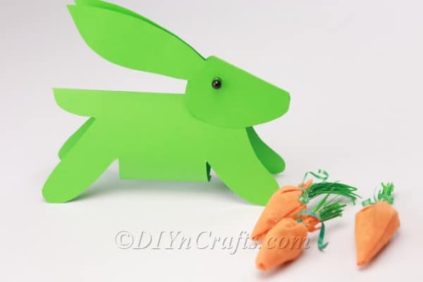 Finished paper bunny with cute paper carrots.