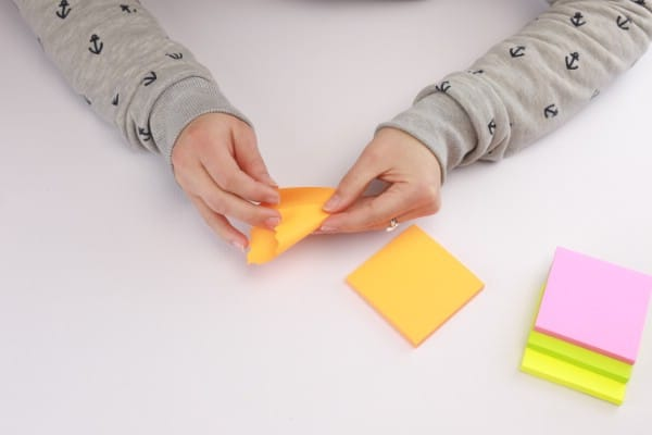 Folding the sticky notes.