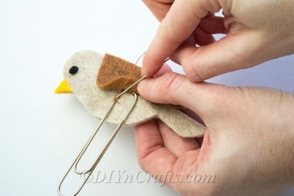 Sew felt onto paper clip to secure