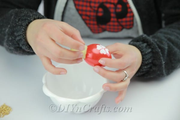 Filling the decorated empty eggshell with wet cotton.