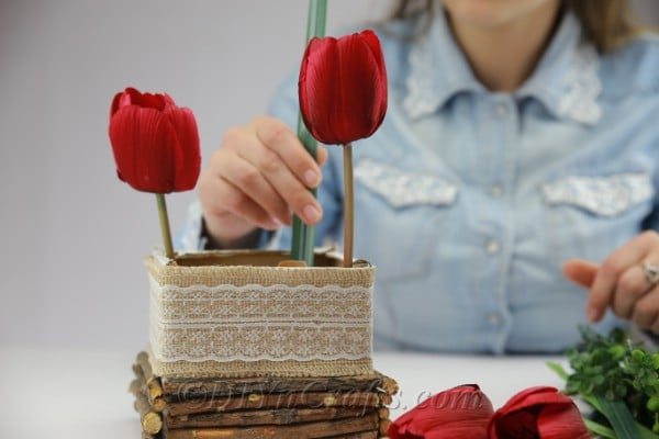 Fill the box with flowers and embellishments
