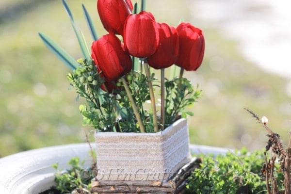 Finished flower box filled with tulips.
