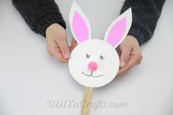 Glue a Popsicle or craft stick onto the bunny's neck.
