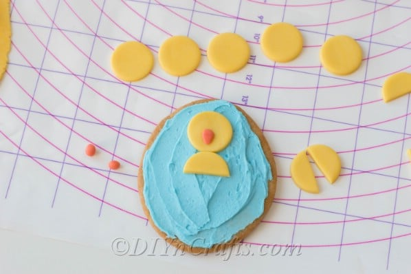 Cute fondant chick on frosted sugar cookie