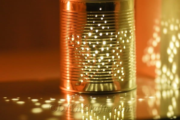 Tin can lit up with a candle