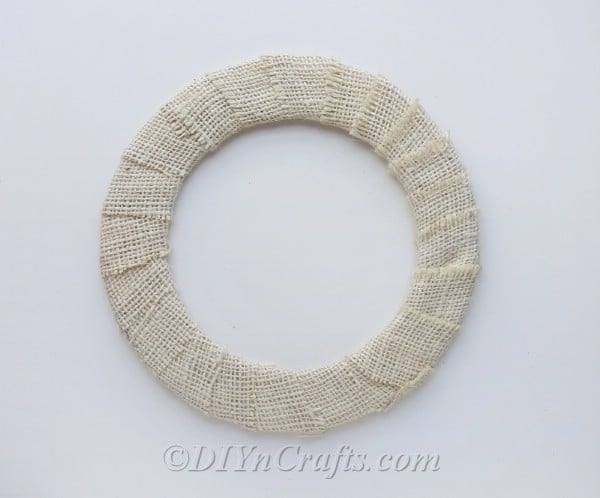Cover wreath form with burlap