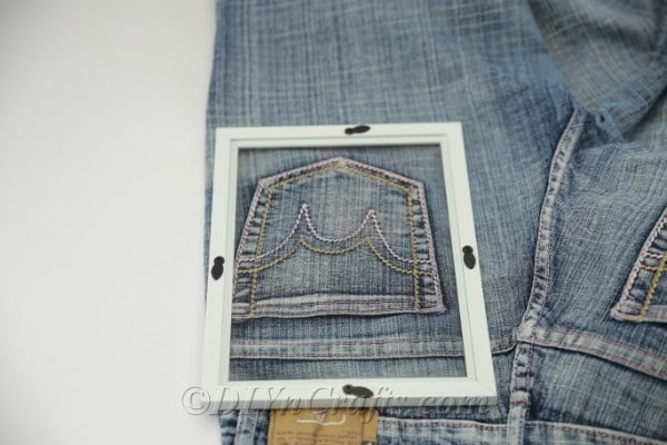 Measuring frame against denim pocket