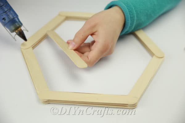 Layering sticks to create the shelf