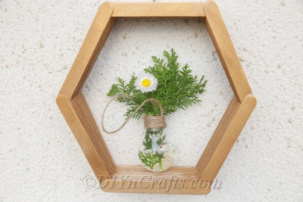 Hexagon shelf with bulb flower vase