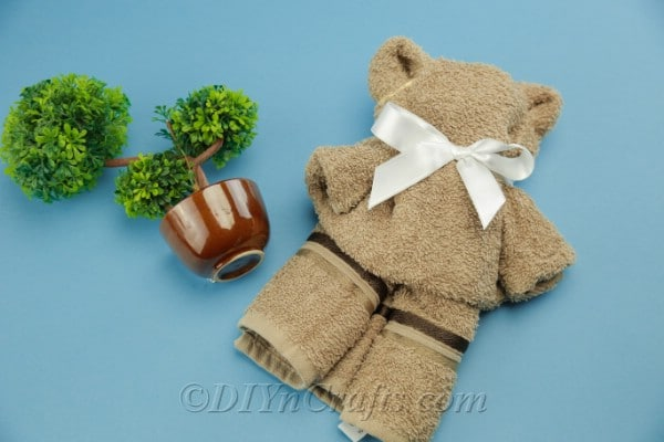 A washcloth teddy bear for a baby shower gift