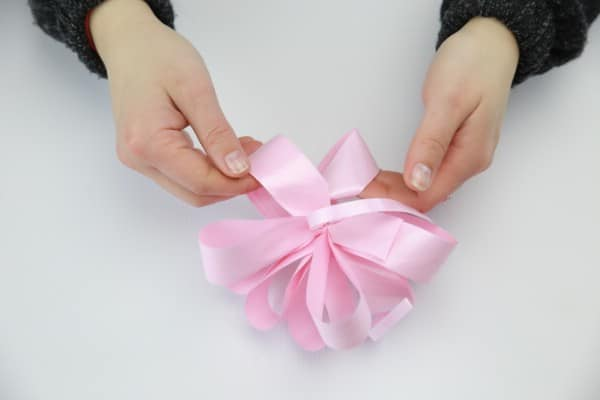 Creating the decorative bow.