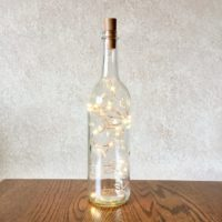 Clear Wine Bottle With Rustic Copper Twinkle Fairy Lights Powered from Cork