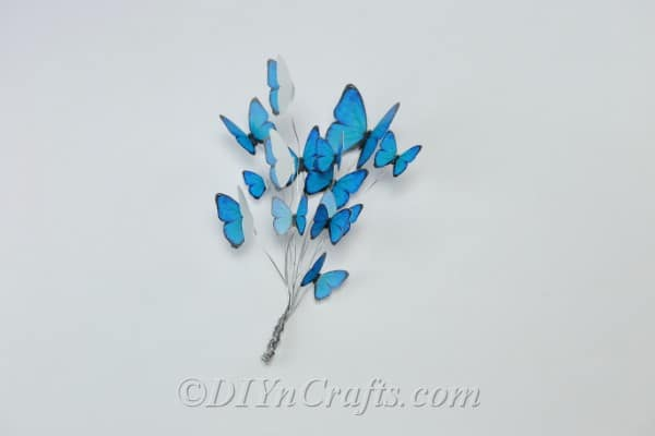 Wire with blue butterflies on top