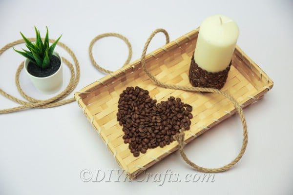 Coffee bean candle on the tray