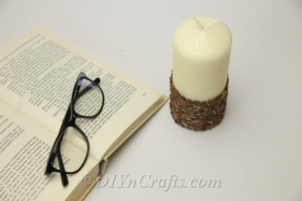 DIY coffee bean candle and newspaper