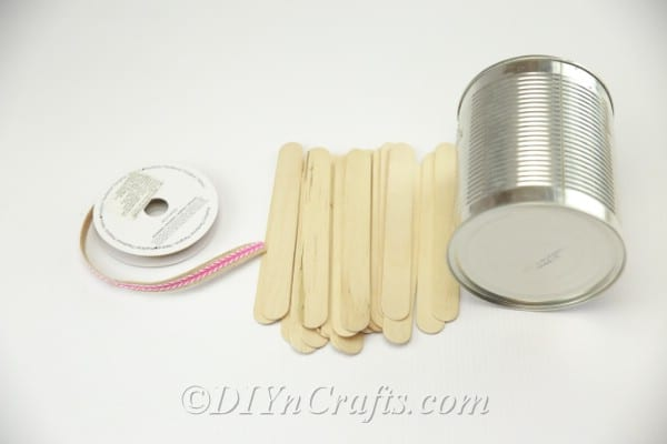 Supplies needed to make popsicle stick covered pencil holder