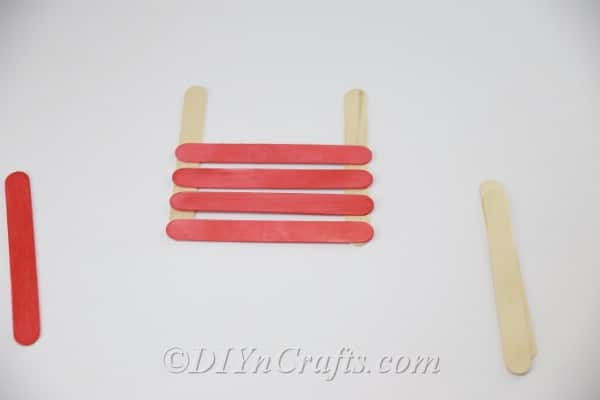 Gluing plain sticks to colored sticks