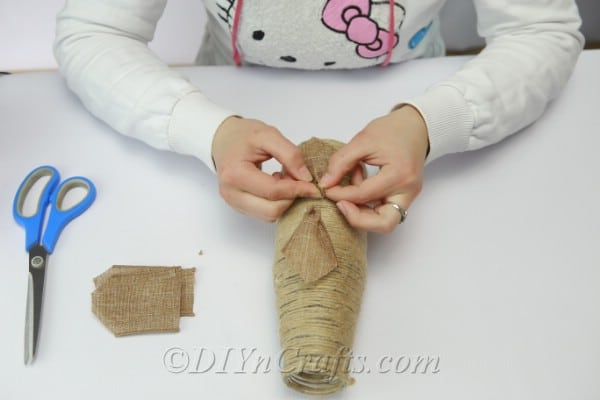 Putting together a flower with burlap ribbon