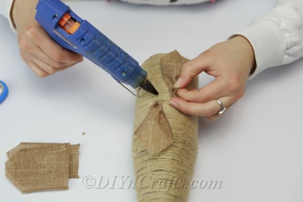 Placing burlap ribbon in a circle to create a flower look