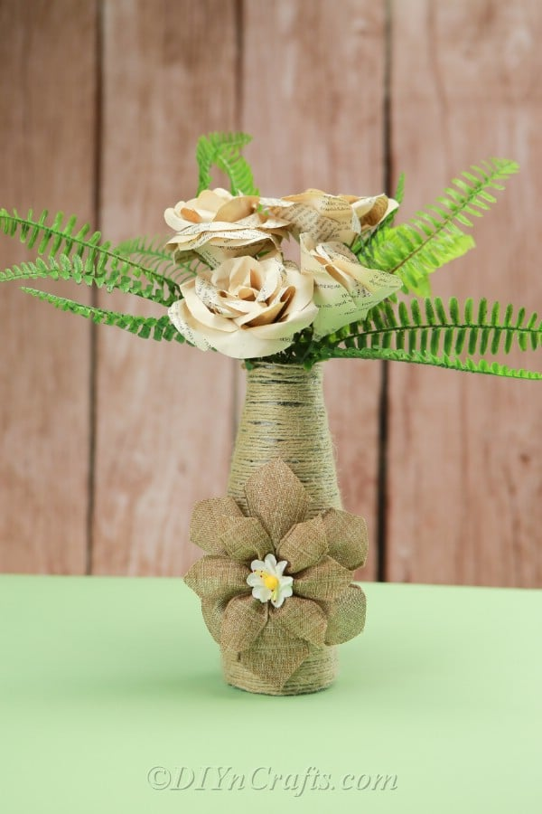 Rope covered vase with greenery