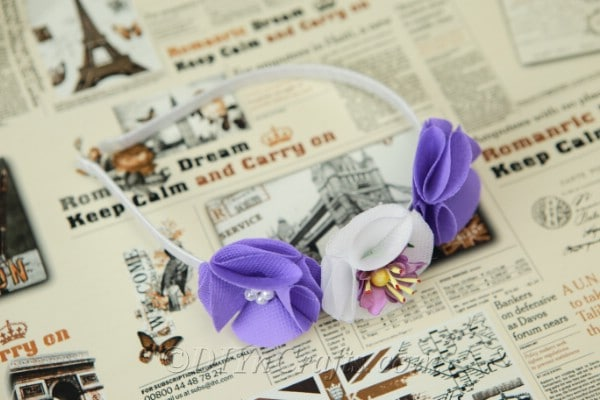 Flower headband laying on a newspaper