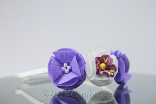 Headband with purple and white flowers
