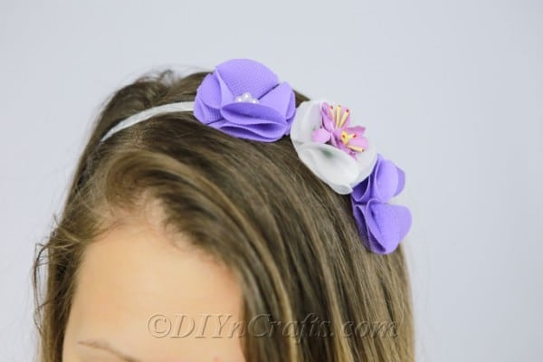 Flower headband with purple and white flowers