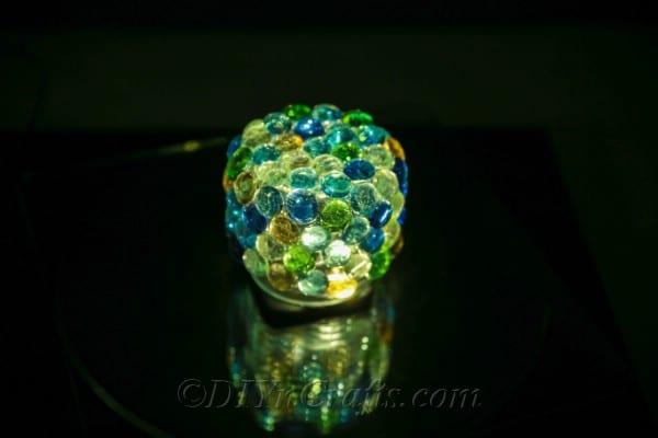 Lit up treasure jar covered in stones