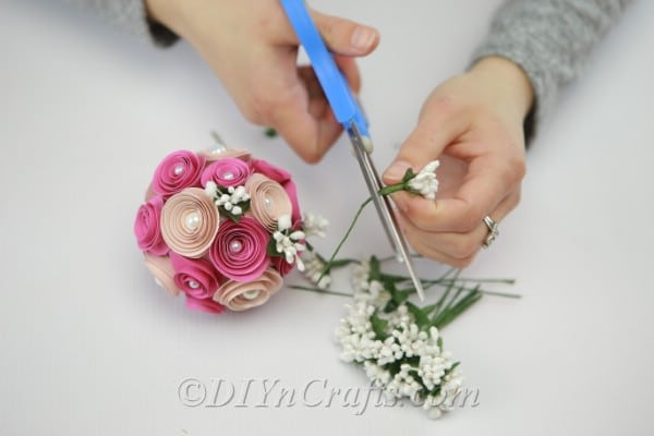 Adding branches and other decorations to DIY floral ball