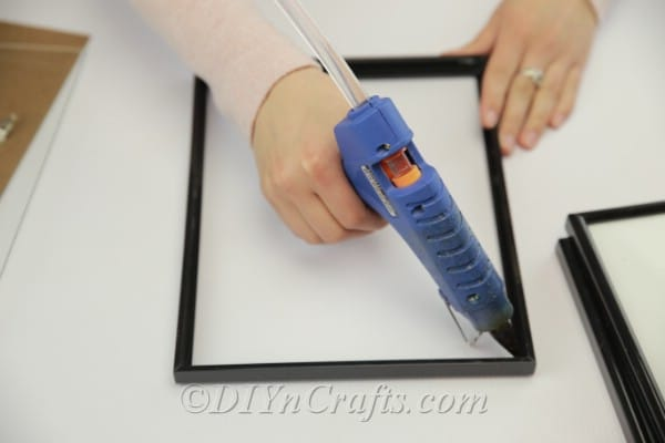 Gluing the glass down in a picture frame
