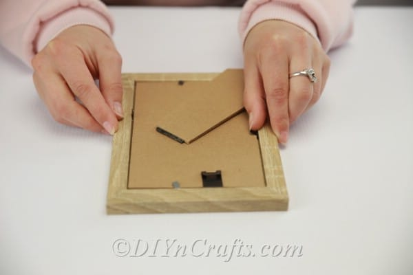 Removing backs and glass from picture frames