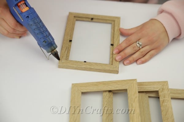 Adding glue to picture frame to hold together