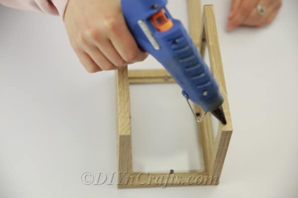 Gluing together picture frames to create a lantern