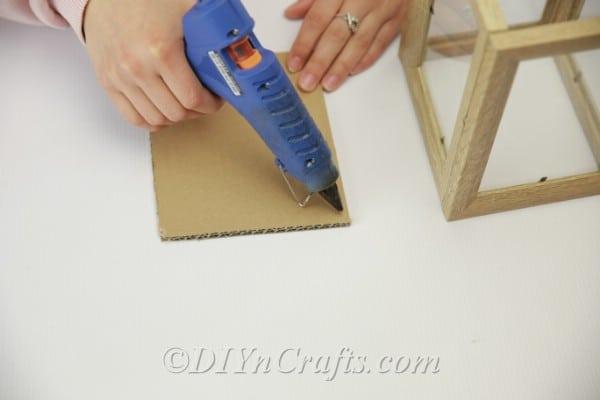 Gluing cardboard onto picture frame lantern base