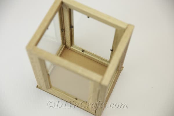 Completed picture frame lantern with cardboard bottom