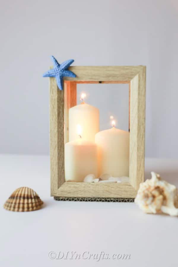 Lantern with candles and shells