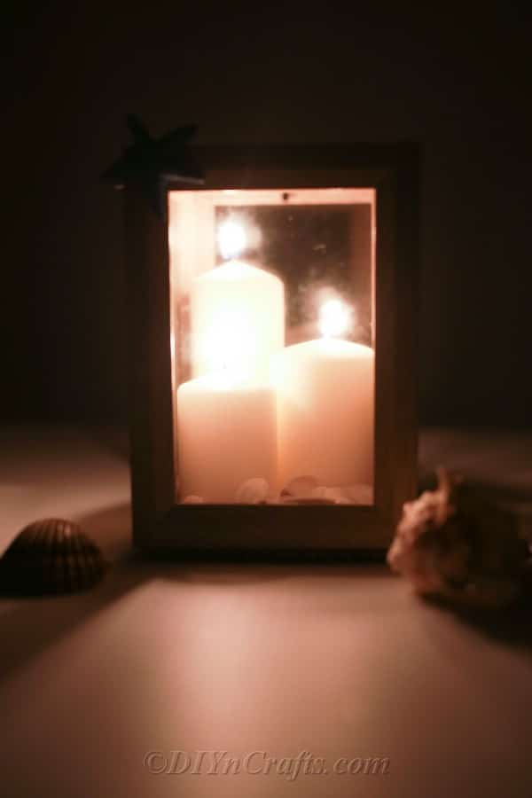 Picture frame lantern lit up with candles