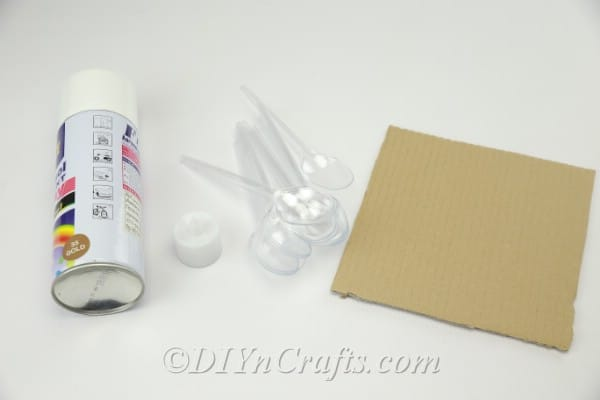 Supplies needed to make a plastic spoon candle holder