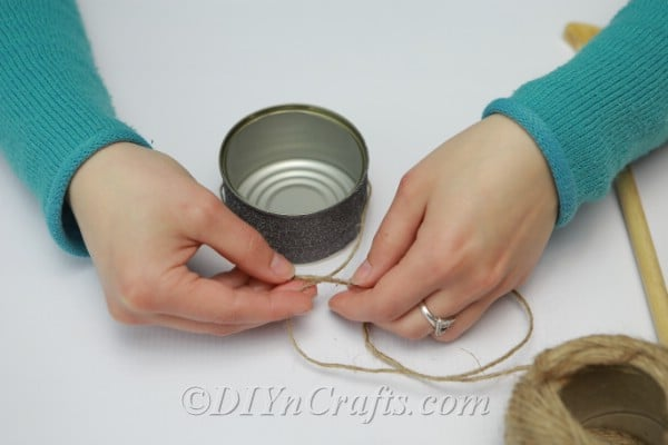 Cutting twine to hang tuna cans