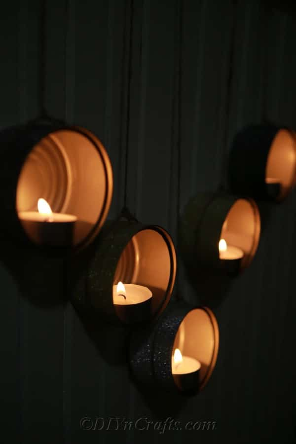 Hanging wooden hanger with tuna can tealights