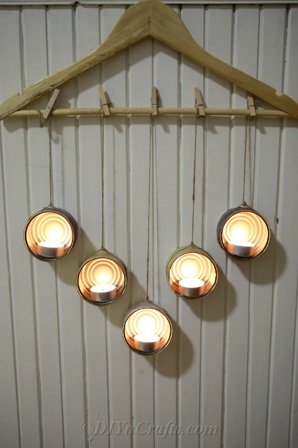 Decorated tuna can tealight holders with lit candles