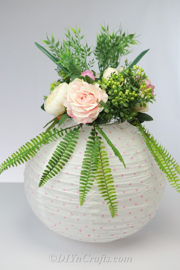 Paper lantern centerpiece with flowers