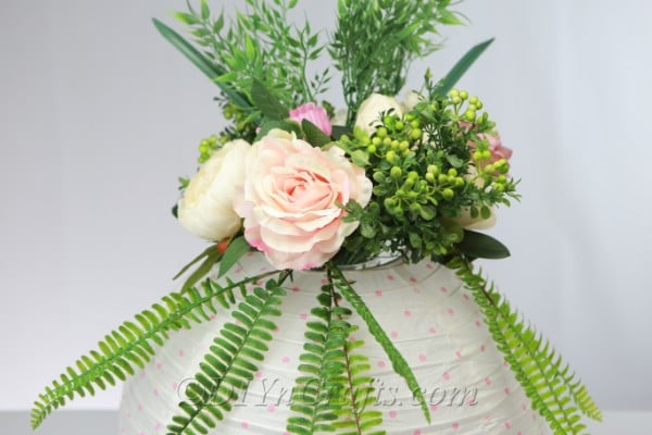 Paper lantern with roses and fern leaves