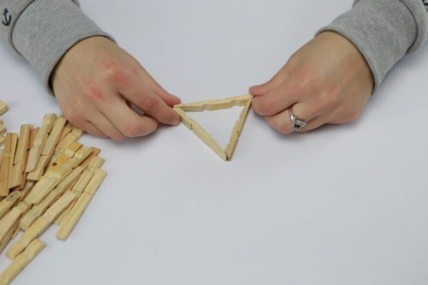 Assembling clothespins to make a lamp