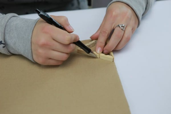 Tracing clothespin lamp onto cardboard