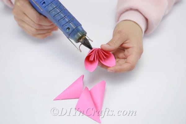 Adding additional leaves to the paper flower