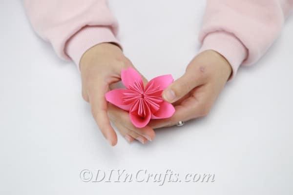 One completed pink paper flower