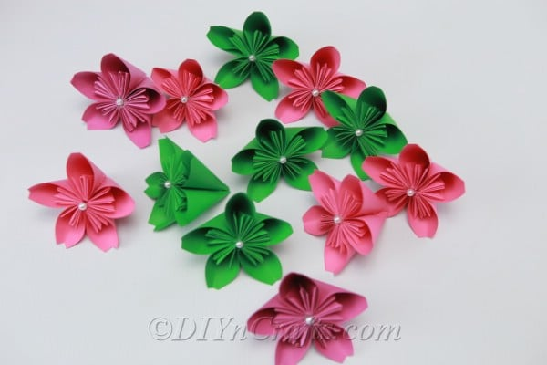 Collection of pink and green paper flowers